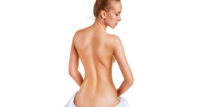 slim woman with her back to the camera
